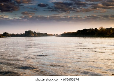 Beautiful Sunrise in the coast of Lujan River in San Fernando, Buenos Aires. San Fernando is the Argentine capital of Nautical