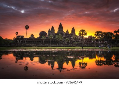"""Beautiful sunrise with colorful sky at Angkor Wat (means """"Temple City), a world heritage site, a temple complex in Siem Reap, Cambodia, the largest religious monument and the 7th wonder of the world."""