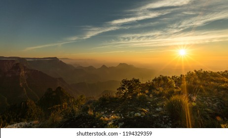 Beautiful sunrise and colorful sky over the hills and canyons during a trekking in Canion do Funil, Urubici, Santa Catarina - Brazil