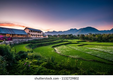 Beautiful sunrise and dramatic clouds seen from a rice terrace in Ruteng, Flores, Indonesia