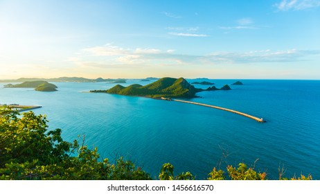 Beautiful sunrise during twighlight time with clouds,Blue sky and mountain around the sea at sattahip,pattaya,chonburi,Thailand