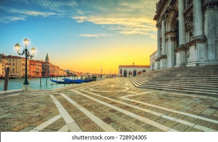 Beautiful sunrise in Grand canal with Church of Santa Maria della Salute, Venice, Italy, European Union. Famous historical heritage.