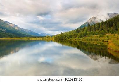 Beautiful sunrise at Kenai River, Alaska, USA. The Kenai River is the longest river in the Kenai Peninsula of south central Alaska