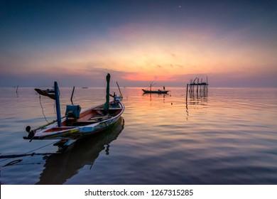 Beautiful sunrise in Kenjeran beach. Kenjeran beach is located in Kenjeran district in the east Surabaya, Indonesia.
