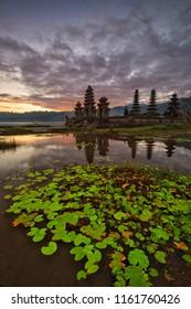 Beautiful sunrise at Lake Tamblingan, Bali, Indonesia