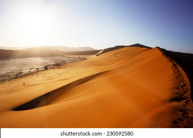beautiful sunrise landscape of hidden Dead Vlei in Namib desert with blue sky, this is best place in Namibia