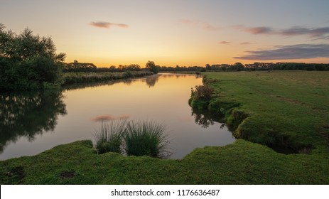 Beautiful sunrise landscape image of River Thames at Lechlade-on-Thames in English Cotswolds countryside