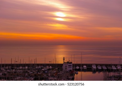 Beautiful sunrise light at Barcelona harbour