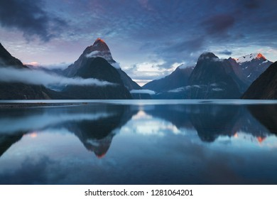 Beautiful sunrise in Milford Sound, New Zealand. - Mitre Peak is the iconic landmark of Milford Sound in Fiordland National Park, South Island of New Zealand Reflection of Mitre peak in the water.