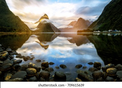 Beautiful sunrise in Milford Sound, New Zealand. - Mitre Peak is the iconic landmark of Milford Sound in Fiordland National Park, South Island of New Zealand.