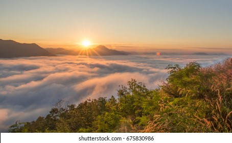 beautiful sunrise in the morning over mountain  with fog.