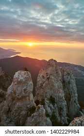Beautiful sunrise in the mountains. Top of Ai Petri mountain sunset view. Crimea, Russia. Vertical
