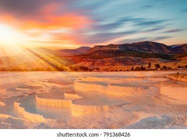 Beautiful sunrise and Natural travertine pools and terraces in Pamukkale. Cotton castle in southwestern Turkey,