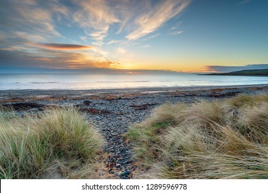 Beautiful sunrise at New England Bay at Kirkmaiden near Ardwell on the Galloway coast of Scotland