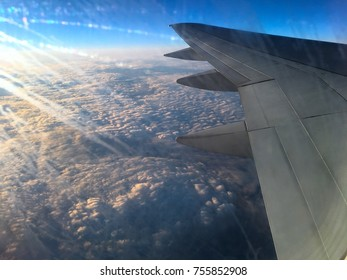 beautiful sunrise on the background of the wing outside the plane