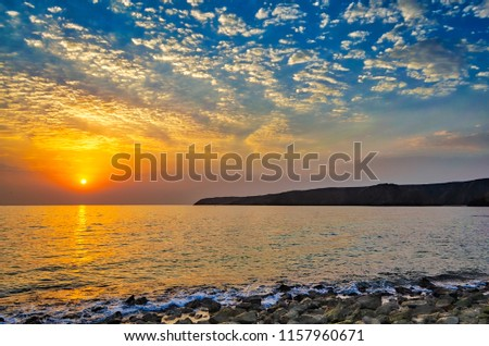 beautiful-sunrise-on-beach-full-450w-115