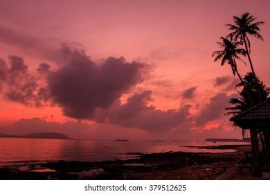 beautiful sunrise on beach and tropical sea in summer