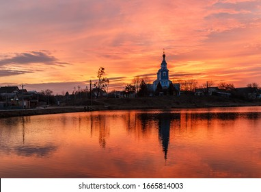 Beautiful sunrise on the lake.  Kiev region.  Boyark town.  February 22, 2020