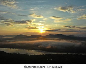 Beautiful Sunrise on mountains and fog on the river