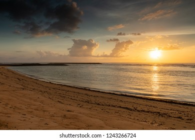 Beautiful Sunrise on a Secluded Beach on the Island of Bali in Indonesia