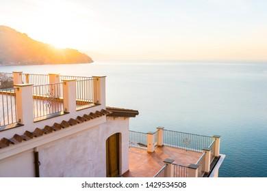 Beautiful sunrise over Amalfi town on Italian coast, Italy