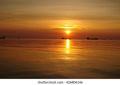 Beautiful sunrise over the Baltic sea in Poland - with ships silhouettes on horizon