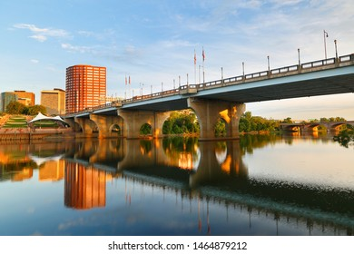 Beautiful sunrise over Connecticut River at Hartford Connecticut. Photo shows the skyline of Hartford, Founders Bridge and Bulkeley Bridge, which  is the oldest  highway bridges  over Connecticut Rive