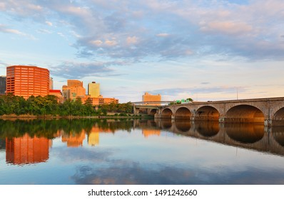 Beautiful sunrise over Connecticut River at Hartford Connecticut. Photo shows the skyline of Hartford and Bulkeley Bridge, which  is the oldest  highway bridges over the Connecticut River in Hartford.