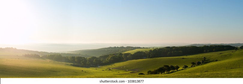 Beautiful sunrise over English countryside landscape in Summer
