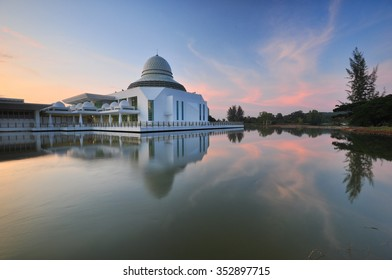Beautiful sunrise over floating mosque. Soft focus due to long exposure shot. Vibrant colors.