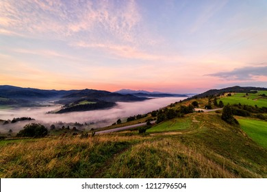 Beautiful sunrise over high rocky peaks and misty and foggy valley in High Tatras mountains on Slovak and Polish border.