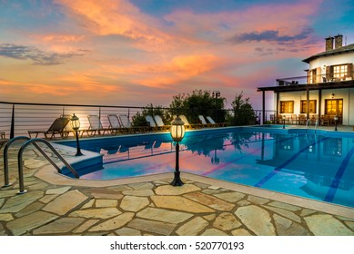 Beautiful sunrise over house and swimming pools