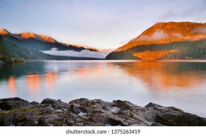 Beautiful sunrise over Lake Crescent at Olympic National Park. The Lake is a deep lake located entirely within Olympic National Park in Clallam County, Washington, USA