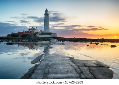 Beautiful sunrise over the lighthouse on St Mary's Island at Whitley Bay on the Northumberland coast