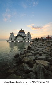 Beautiful sunrise over Malacca Straits Mosque. Soft focus due to long exposure shot.