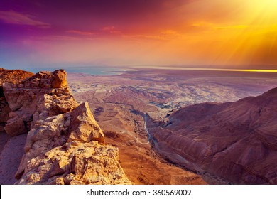 Beautiful sunrise over Masada fortress. Ruins of King Herod's palace in Judaean Desert. Wild nature Israel.