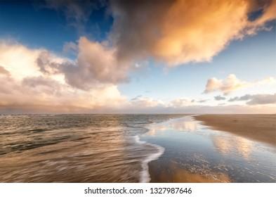 beautiful sunrise over North sea coast, Holland