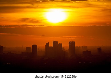 Beautiful sunrise over office building center of Bangkok in Thailand.