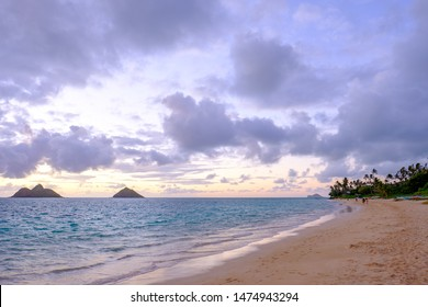 Beautiful sunrise over the Pacific Ocean on a calm and peaceful morning at Lanikai Beach in Hawaii.