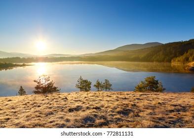 Beautiful sunrise over Ribnicko lake in Zlatibor, Serbia.