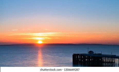 Beautiful Sunrise over the Sea, Bristol Channel and Penarth Pier in Wales, United Kingdom.