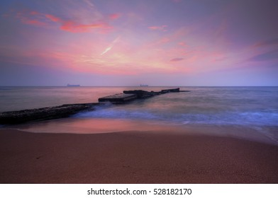 Beautiful sunrise over the sea with dramatic clouds on the sky
