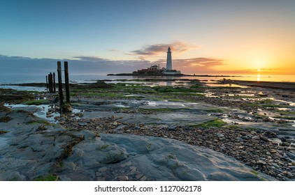 Beautiful sunrise over St Mary's Island and it's lighthouse at Whitley Bay in Tyne and Wear