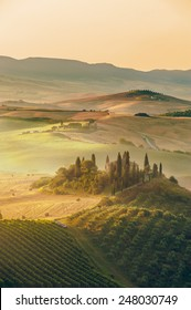 Beautiful sunrise over the Val d'Orcia in Tuscany, natural park included in the heritages list of UNESCO