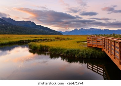 Beautiful sunrise at Potter Marsh Wildlife Viewing Boardwalk, Anchorage, Alaska. Potter Marsh is located at the southern end of the Anchorage Coastal Wildlife Refuge.