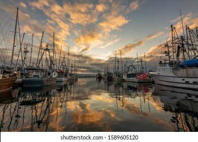 Beautiful sunrise reflection on Comox Fishermans Warf in Comox Valley, British Columbia, Canada