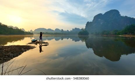 Beautiful sunrise and reflections at natural lagoon, Nongtalay lagoon in Krabi Province, Thailand.
