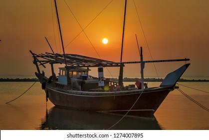 Beautiful Sunrise scene Boat alone seaside at Dammam Corniche Saudi Arabia.