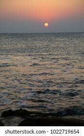 Beautiful sunrise  in the sea background.