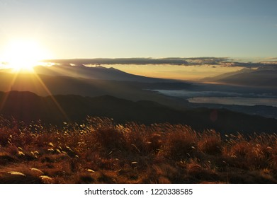 """Beautiful Sunrise and """"sea of cloud"""" view of Suwa city from """"Takabocchi"""" in Nagano Prefecture, Japan. Nov. 3, 2018"""